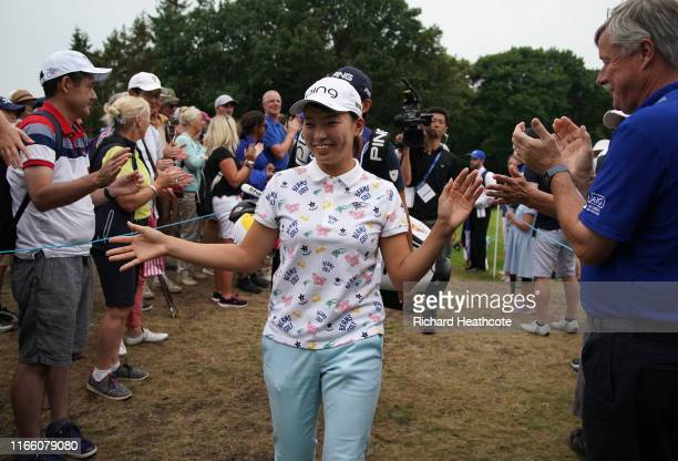 Hinako Shibuno of Japan high fives spectators as she walks to the 18th tee during the final round of the AIG Women's British Open at Woburn Golf Club...