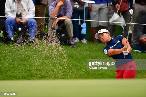 Hinako Shibuno of Japan hits out from a bunker on the 8th hole during the first round of the Stanley Ladies at Tomei Country Club on October 11, 2019...