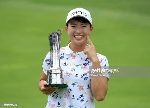 Hinako Shibuno of Japan holds the trophy after her one shot victory in the final round of the AIG Women's British Open on the Marquess Course at...