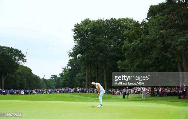 Hinako Shibuno of Japan holes the winning putt on the 18th green during Day Four of the AIG Women's British Open at Woburn Golf Club on August 04,...