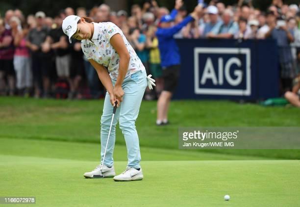 Hinako Shibuno of Japan holes the winning putt on the 18th green to win the AIG Women's British Open during Day Four of the AIG Women's British Open...