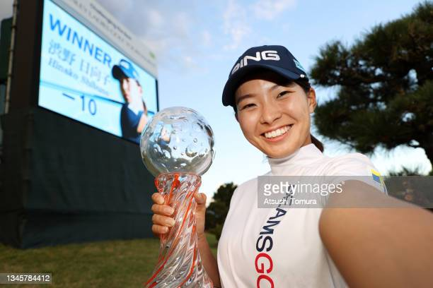 Hinako Shibuno of Japan imitates a selfie after winning the tournament following the final round of the Stanley Ladies at Tomei Country Club on...