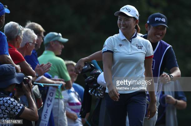 Hinako Shibuno of Japan is all smiles as she walks off the 17th green during Day Two o the AIG Women's British Open at Woburn Golf Club on August 02...
