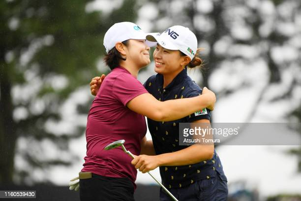 Hinako Shibuno of Japan is congratulated by MinYoung Lee of South Korea after winning the tournament through the playoff on the 18th green following...