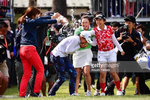 Hinako Shibuno of Japan is congratulated by Momoko Osato Yui Kawamoto and Nana Suganuma after winning the tournament after the final round of the...