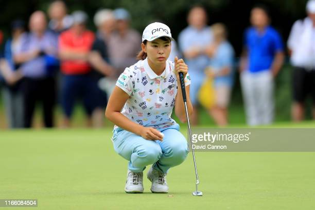 Hinako Shibuno of Japan lines up a birdie putt on the par 5 15th hole during the final round of the AIG Women's British Open on the Marquess Course...