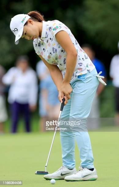 Hinako Shibuno of Japan makes a birdie putt on the par 5 15th hole during the final round of the AIG Women's British Open on the Marquess Course at...