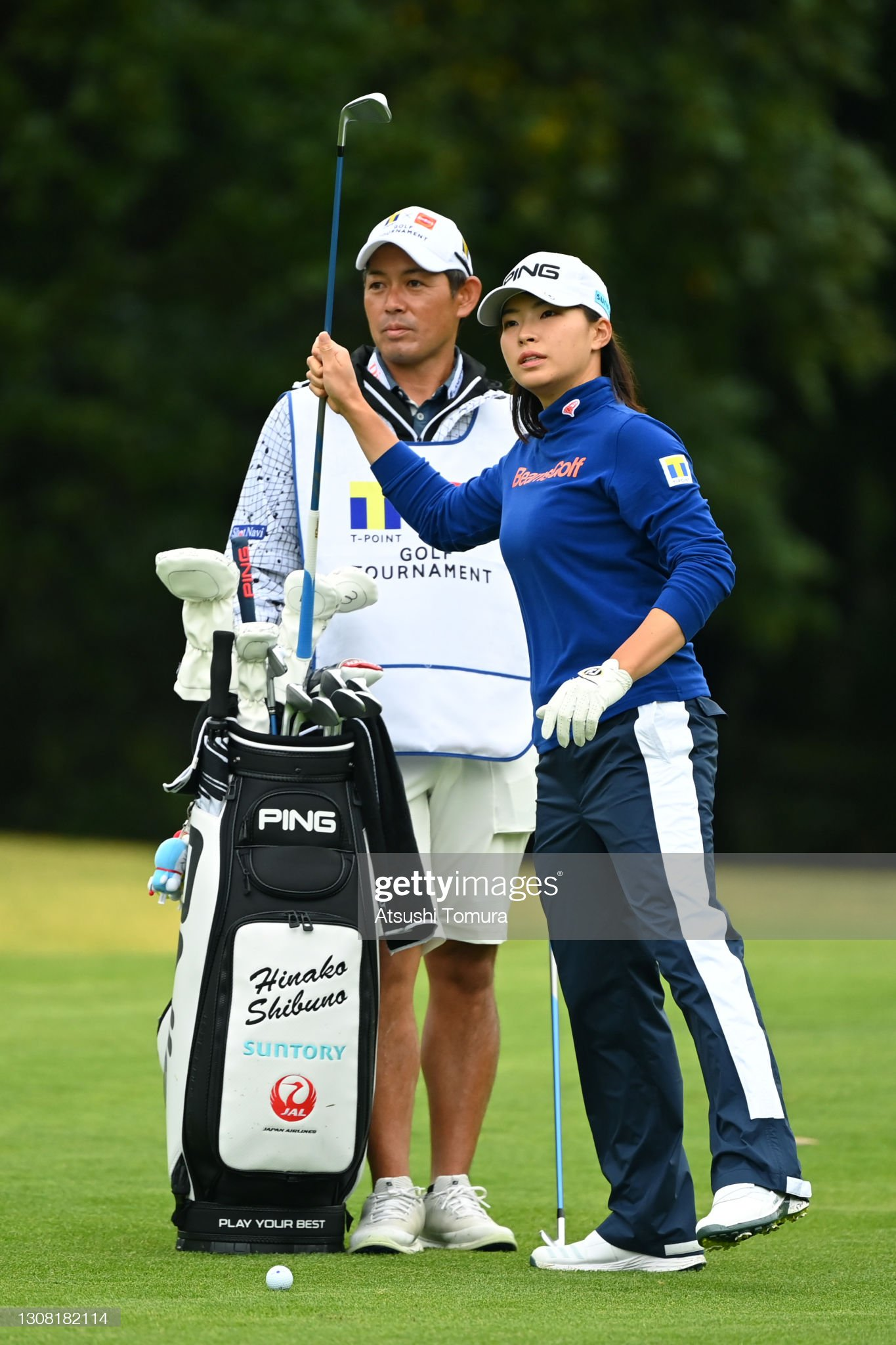 https://media.gettyimages.com/photos/hinako-shibuno-of-japan-picks-an-iron-up-from-her-caddie-bag-before-picture-id1308182114?s=2048x2048