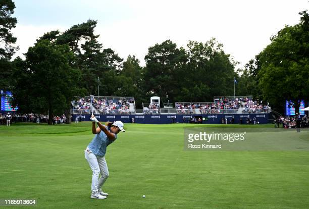 Hinako Shibuno of Japan plays her second shot on the par four 18th hole during the third round of the AIG Women's British Open at Woburn Golf Club on...