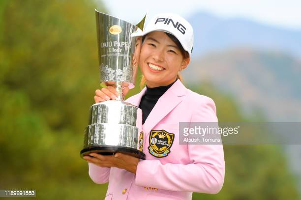 Hinako Shibuno of Japan poses with the trophy after winning the tournament following the final round of the Daio Paper Elleair Ladies at Elleair Golf...