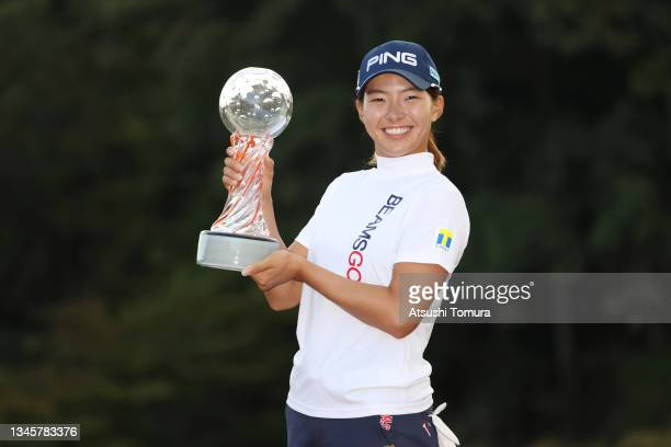 Hinako Shibuno of Japan poses with the trophy after winning the tournament following the final round of the Stanley Ladies at Tomei Country Club on...