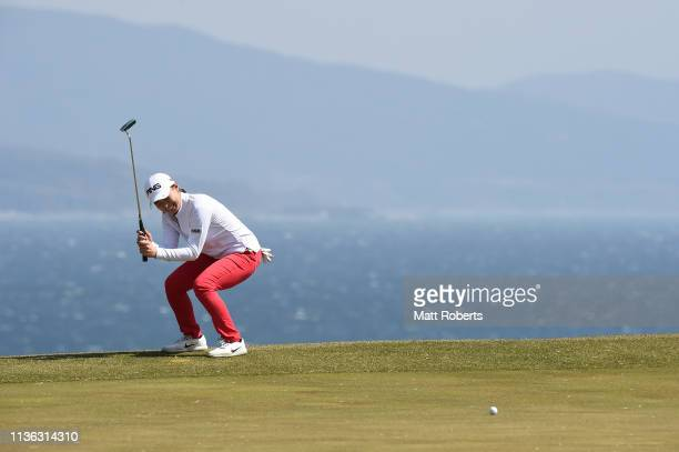 Hinako Shibuno of Japan reacts after her putt on the 16th green during the final round of the Yokohama Tire Golf Tournament PRGR Ladies Cup at Tosa...