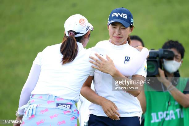 Hinako Shibuno of Japan sheds tears as she is congratulated by Seonwoo Bae of South Korea after winning the tournament through the playoff following...
