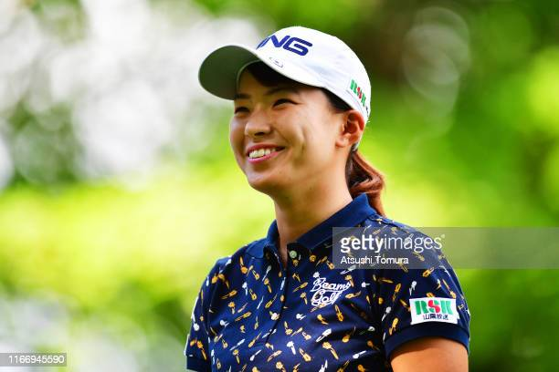 Hinako Shibuno of Japan smiles after her tee shot on the 14th hole during the first round of the Hokkaido meiji Cup at Sapporo International Country...