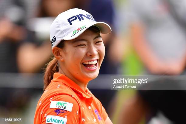Hinako Shibuno of Japan smiles after her tee shot on the 5th hole during the first round of Karuizawa 72 Golf Tournament at Karuizawa 72 Golf North...