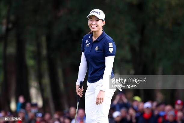Hinako Shibuno of Japan smiles after holing out with the birdie on the 18th green during the final round of the LPGA Tour Championship Ricoh Cup at...