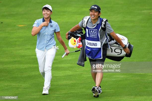 Hinako Shibuno of Japan speaks to her caddie on the 18th fairway during Day Three of the AIG Women's British Open at Woburn Golf Club on August 03...
