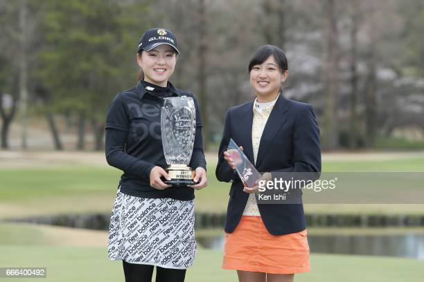 Hinako Yamauchi holds a winning trophy and Yuna Takagi holds a best amateur trophy after the final round of the Hanasaka Ladies Yanmar Golf...