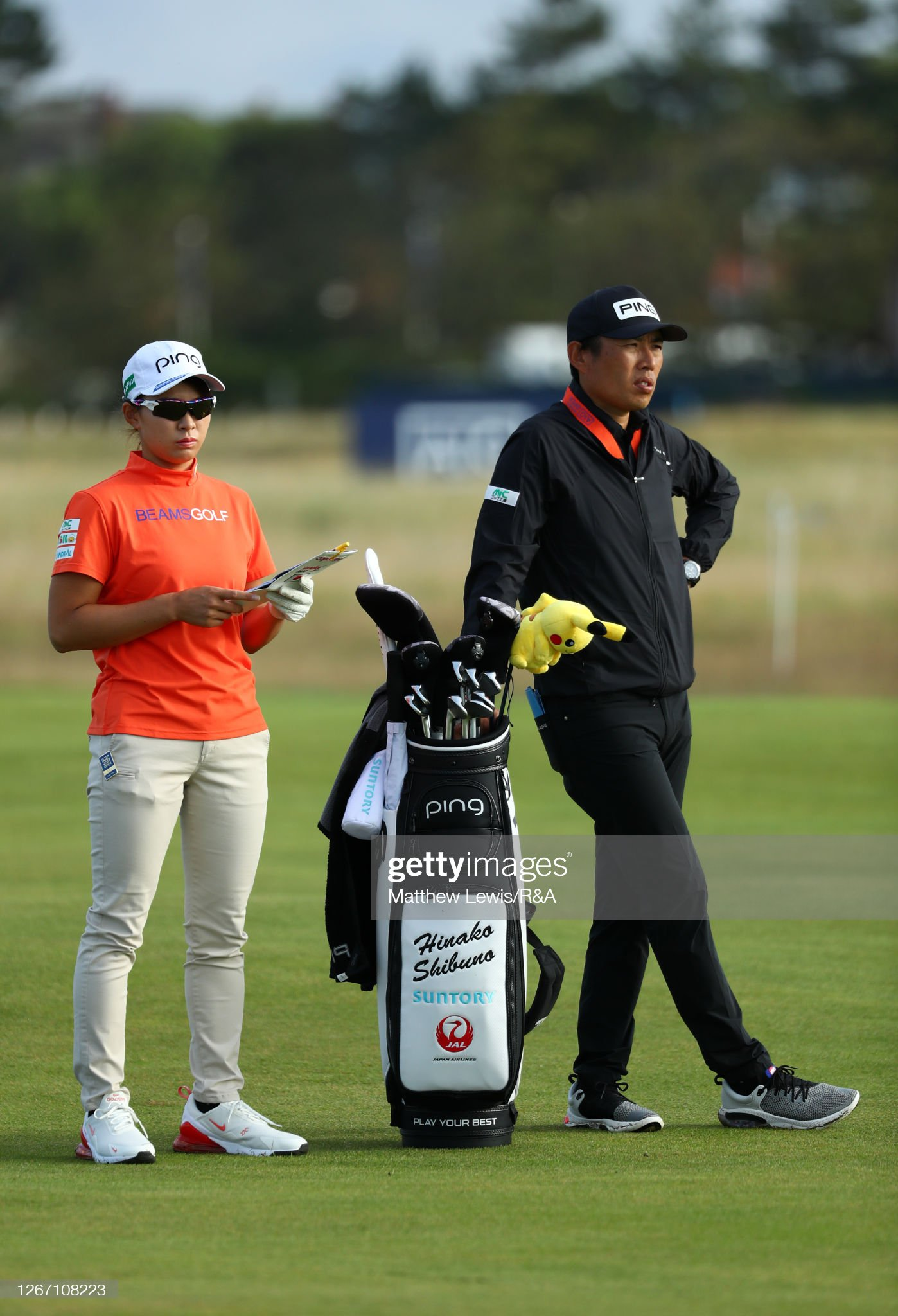https://media.gettyimages.com/photos/hinakoshibuno-of-japan-speaks-to-her-caddie-sho-aoki-during-a-round-picture-id1267108223?s=2048x2048