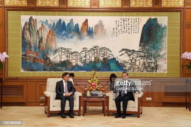 Çhina's Foreign Minister Wang Yi meets with Malaysia's People's Justice Party president and leader of the Pakatan Harapan coalition Anwar Ibrahim at...