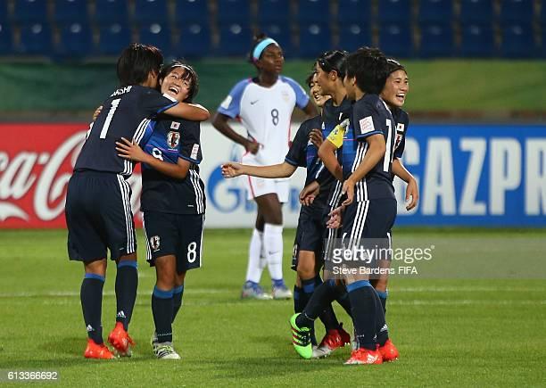 Hinata Miyazawa of Japan celebrates scoring a goal with her team mates during the FIFA U-17 Women's World Cup Jordan 2016 Group D match between Japan...