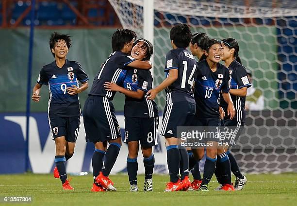 Hinata Miyazawa of Japan celebrates with team mates after scoring her team's third goal during the FIFA U-17 Women's World Cup Group D match between...