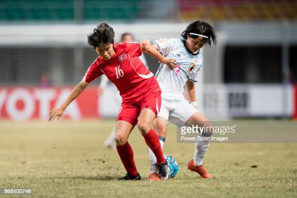 """Hinata Miyazawa of Japan fights for the ball with An Song Ok of DPR Korea during their AFC U-19 Women""""u2019s Championship 2017 Final match between..."""