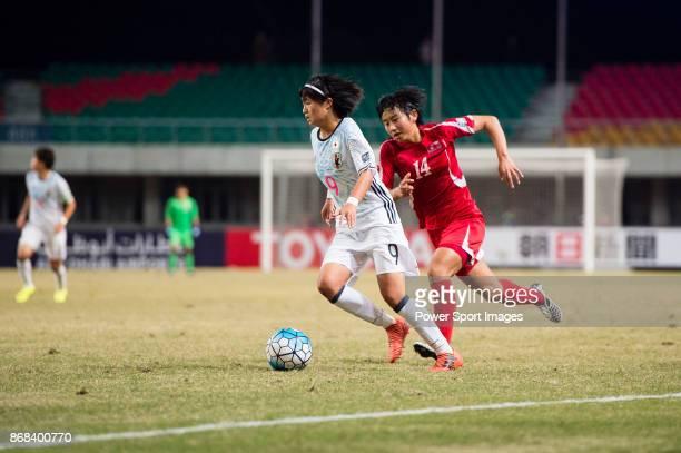 "Hinata Miyazawa of Japan fights for the ball with Rim Jin A of DPR Korea during their AFC U-19 Women""u2019s Championship 2017 Final match between..."