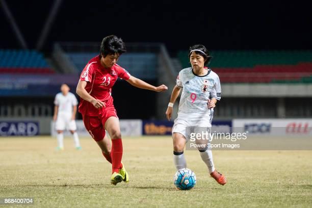"Hinata Miyazawa of Japan in action against Ju Hyo Sim of DPR Korea during their AFC U-19 Women""u2019s Championship 2017 Final match between North..."