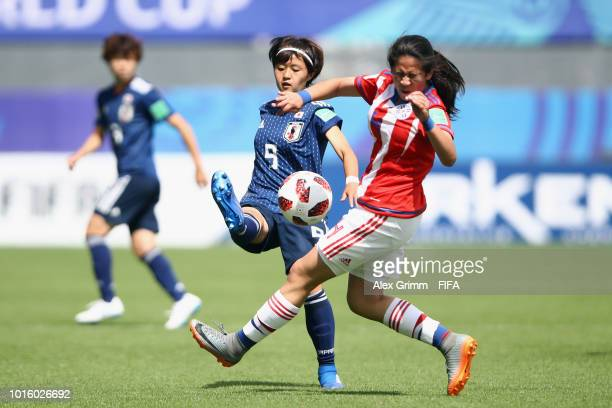 Hinata Miyazawa of Japan is challenged by Deisy Ojeda of Paraguay during the FIFA U-20 Women's World Cup France 2018 group C match between Japan and...