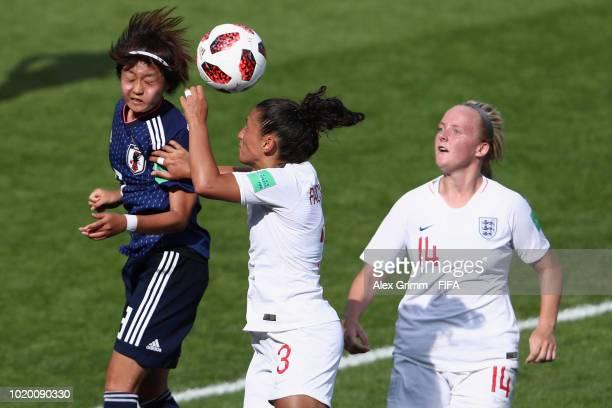 Hinata Miyazawa of Japan is challenged by Mayumi Pacheco and Chloe Peplow of England during the FIFA U-20 Women's World Cup France 2018 Semi Final...