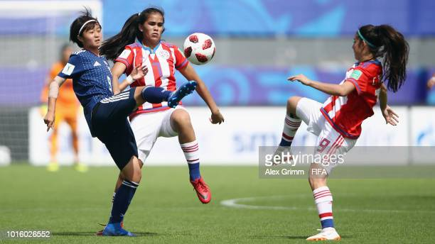 Hinata Miyazawa of Japan is challenged by Rosa Mino and Celeste Aguilera of Paraguay during the FIFA U-20 Women's World Cup France 2018 group C match...