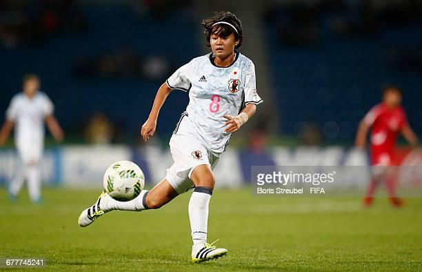 Hinata Miyazawa of Japan runs with the ball during the FIFA U-17 Women's World Cup Finale match between Korea DPR and Japan at Amman International...