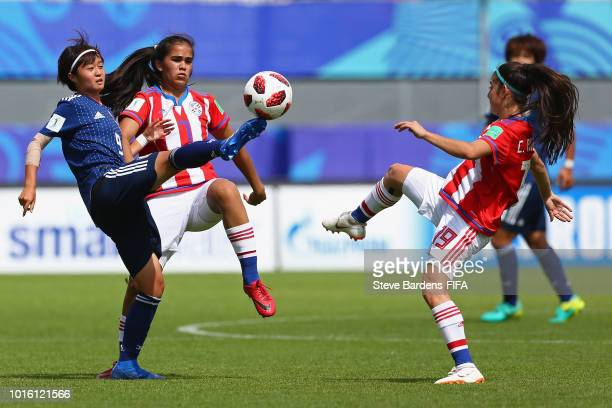 Hinata Miyazawa of Japan wins the ball from Rosa Mino and Celeste Aguilera of Paraguayduring the FIFA U20 Women's World Cup France 2018 group C match...