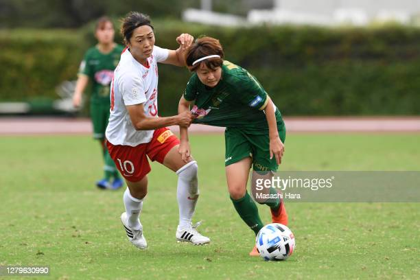 Hinata Miyazawa of NTV Beleza and Kozue Ando of Urawa Reds Ladies compete for the ball during the Nadeshiko League match between Nippon TV Tokyo...