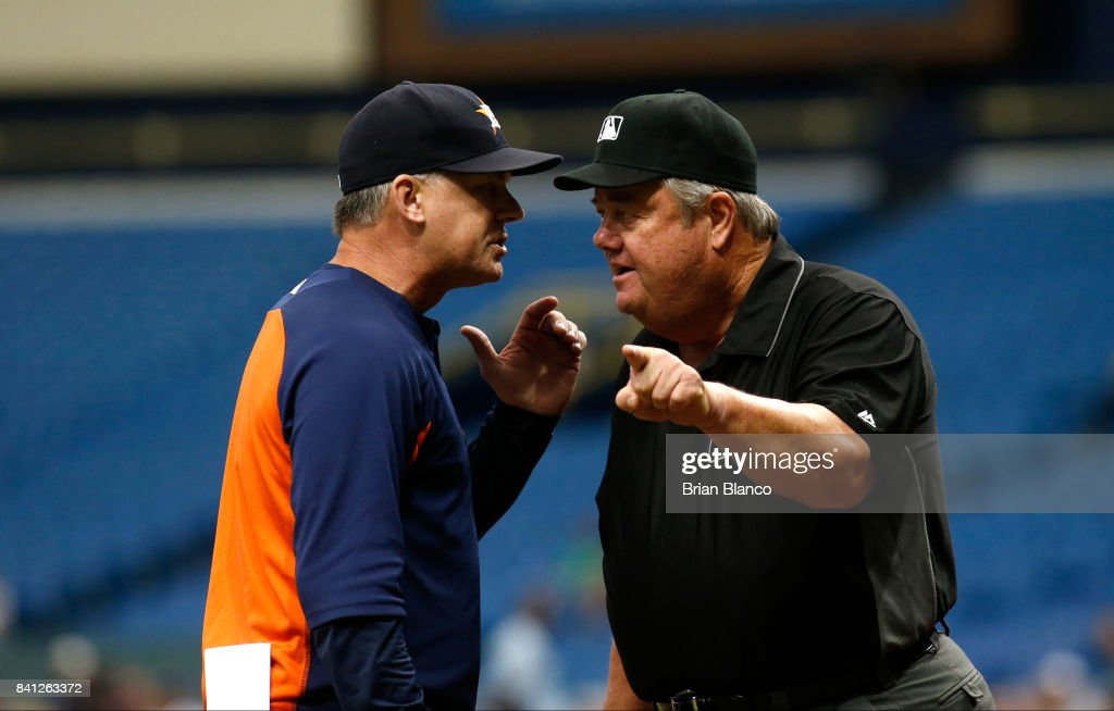 A.J. Hinch #14 of the Houston Astros has an exchanged with umpire Joe West #22 moments after West ejected Hinch during the first inning of a game on August 31, 2017 at Tropicana Field in St. Petersburg, Florida.