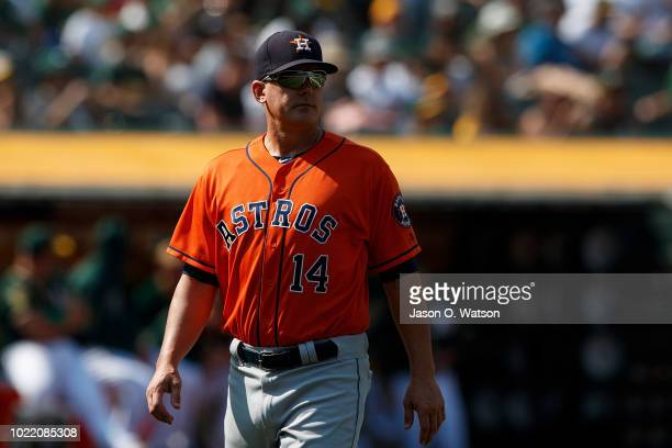 Hinch of the Houston Astros returns to the dugout after making a lineup change during the eighth inning against the Oakland Athletics at the Oakland...