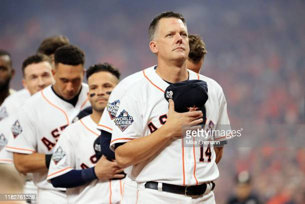 Hinch of the Houston Astros stands for the national anthem prior to Game One of the 2019 World Series against the Washington Nationals at Minute Maid...