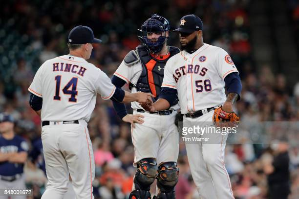 J Hinch of the Houston Astros takes the ball from Francis Martes in the eighth inning against the Seattle Mariners at Minute Maid Park on September...