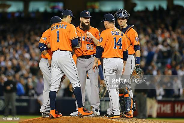 J Hinch of the Houston Astros tallks with Dallas Keuchel of the Houston Astros on the mound during the sixth inning against the New York Yankees...