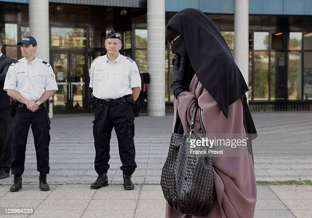 Hind Ahmas leaves the court after being convicted as the first woman wearing a niqab after France's nationwide ban on the wearing of face veils on...