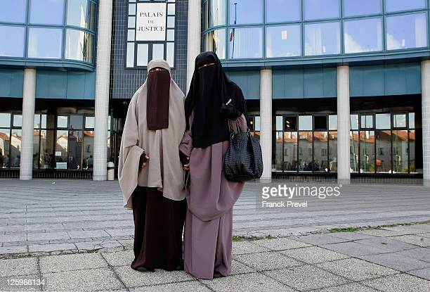 Hind Ahmas stands with Kenza Drider as she leaves the court after being convicted as the first woman wearing a niqab after France's nationwide ban on...