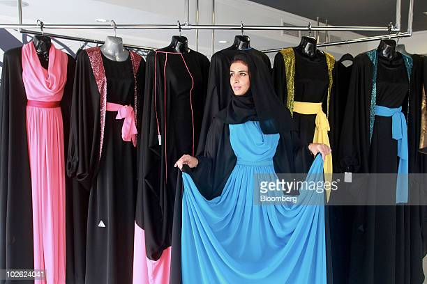 Hind Beljafla wearing an abaya from the Das Collection poses for a photograph at her store in Dubai United Arab Emirates on Sunday July 4 2010 Hind...