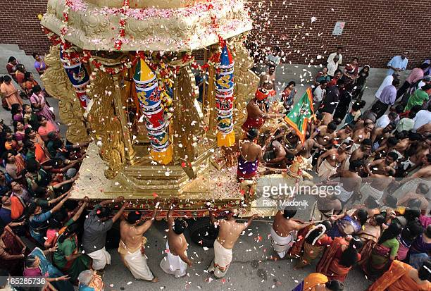 hindu 07/20/04 TORONTO ONTARIO Thousands gathered this morning at Sridurka Hindu Temple in North York to celebrate the chariot festival in which the...