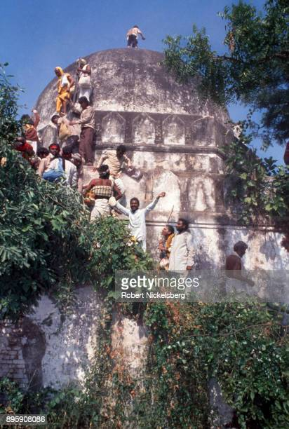 Hindu activists climb the dome of the Babri Mosque October 30 1990 in Ayodhya India The Hindu rightwing party Bharatiya Janata Party BJP organized a...