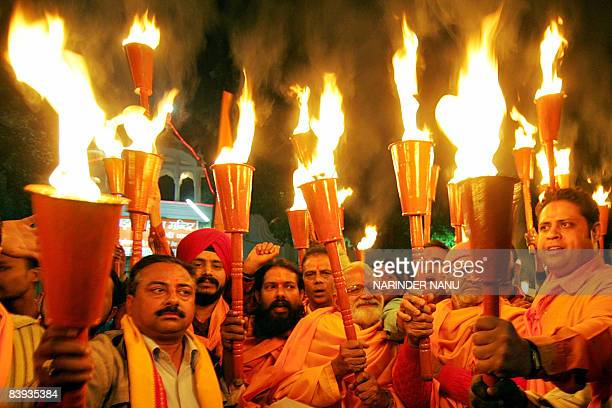 Hindu activists from the Bajrang Dal Party hold torches during a procession in Amritsar on December 6 2008 as they mark the 16th anniversary of the...