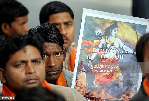 Hindu activists of Shiv Sena listen as their leaders demand the construction of the Ram Temple on the site of the demolished Babri Masjid in Ayodhya...