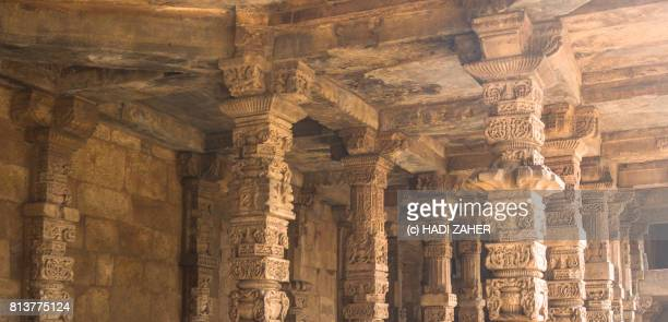 hindu and jain pillars at qutub minar | delhi | india - jain stock photos and pictures