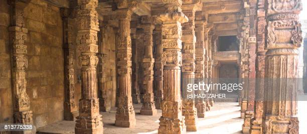 hindu and jain pillars at qutub minar | delhi | india - jain temple stock photos and pictures