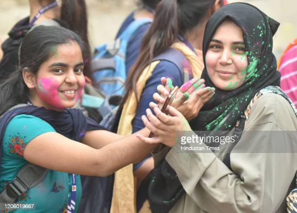 Hindu and Muslim students playing with Abir pre holi celebration outs side of Patna Women College at Bailey road on March 7 2020 in Patna India